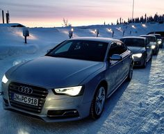 Audi A5's in the snow.