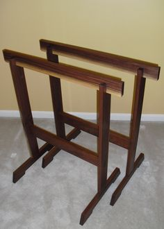 KRENOVIAN SAWHORSES:  based on a design in Fine Woodworking, capable of supporting 3-400 lbs of lumber or nice enough to rest a make shift slab for a dining table. Shown in walnut.