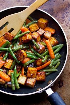Tofu and veggie stir fry made with a special technique to make tofu crispy and give it more flavor! Serve with rice or by itself - a healthy tofu takeout.