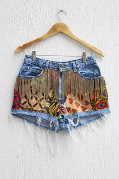Vintage Denim cutoff shorts featuring allover distressing and a raw hem. Handmade embroidery patches at the front and chain fringe Measures *Waist : 30 *Hips: up to 38 *Rise: *Inseam: 2 Excellent vintage condition ! One of a kind ! Denim Vintage, Jean Vintage, Vintage Shorts, Cutoff Jean Shorts, Denim Cutoffs, High Waisted Shorts, Waisted Denim, Long Shorts, Summer Shorts