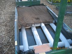 """The float valve is located in the waste basket, which makes this an """"automatic watering sub -irrigated raised bed planter"""