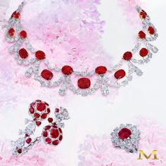 Ruby blossoms! A gorgeous exquisite ruby and diamond suite... only by the House of Moussaieff