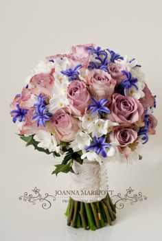 Bridal Bouquet made of mauve roses, white narcissus and purple hyacinths. Spring wedding theme.
