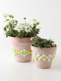 This is a wonderful idea to renew old flower pots. Check out how to do it under http://www.designsponge.com/2011/04/diy-project-faceted-gem-flower-pots.html