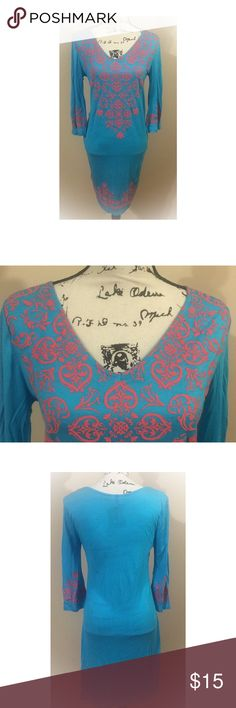 Super Soft Beach Coverup. Super soft beach coverup. Could also fit a medium. Beautiful blue color.... Coral pink color swirls. South Main Dresses