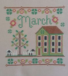 completed cross stitch Country Cottage March house