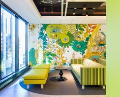This one is a good example of playing with designs and decorations. The wallpaper isn't really what you see often on offices but it's relaxing to the eye and plus the sofa and the good view, it's a place suitable for little coffee breaks and chats with officemates.
