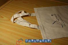 Bolsas de tela con logotipo.