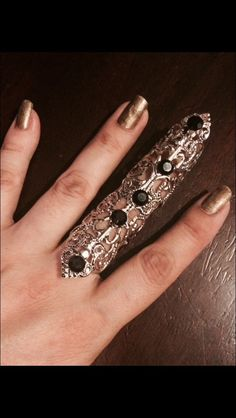 A personal favorite from my Etsy shop https://www.etsy.com/listing/250387729/shield-full-finger-ring-vintage-style