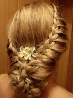 Definitely one of my top picks! I absolutely love the looseness to the hairdo! I love the soft addition of the flower! The braids are so me! I would need to see it from the front, but this is definitely in the top 5.