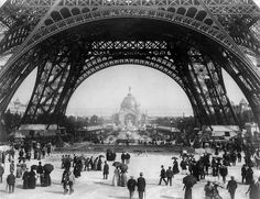 Paris Exposition, view from ground level of the Eiffel tower with Parisians promenading, 1889
