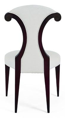 Description A curved wasp waist and hand carved scroll detailing are perfectly balanced by elegant straight legs on this contemporary dining chair inspired by the female form. Code 30-0026
