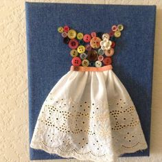 I love this dress. On a denim canvas I added lots of lovely vintage buttons to shape the top of the dress. It has a very pretty flower button