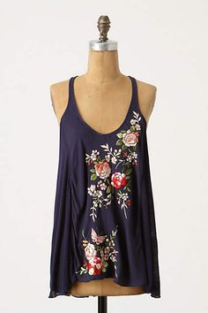 Love bright flowers against background. Pops. Cool tank. Nature print.