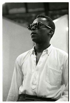 Miles Davis in button down pop over.