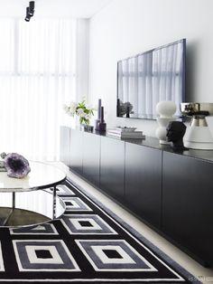 Modern sideboard and geometric rug.