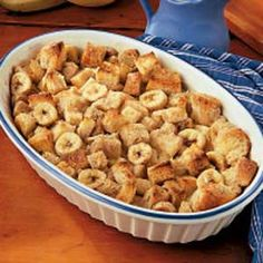 Banana Bread Pudding - With its crusty golden top, custard-like inside and smooth vanilla sauce, this bread pudding is a real homespun dessert.
