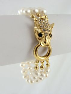 Freshwater pearl bracelet with stunning gold leopard head clasp