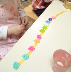 clipping hair clips to ribbon--excellent fine motor activity