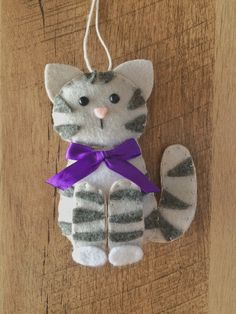 Items similar to Cat Ornament - Personalized Ornament - Cat Gift - Cat Christmas Ornament - Felt Ornament - Tabby Cat - Kitten Ornament on Etsy Felt Christmas Decorations, Felt Christmas Ornaments, Fundraising Crafts, Felt Ornaments Patterns, Felt Animal Patterns, Felt Crafts Diy, Felt Birds, Felt Cat, Sewing Projects For Kids