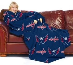 """NHL Washington Capitals Comfy Throw Blanket with Sleeves by Northwest. $15.81. Made of soft, thick, luxurious fleece with oversized loose fitting sleeves, the Comfy Throw, Officially Licensed NHL Blanket by Northwest lets shoulders, arms and upper body remain protected from the cold while leaving arms and hands free to use a Laptop, TV remote, Read a Book, Talk on the Phone, Eat a Snack or Enjoy an Outdoor Sports Event. Measures 48"""" x 71"""" and Features Team Offical Logo and N..."""