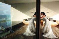 Bride getting ready for her destination wedding at the Nizuc Resort in Cancun. Dress by @Arienne Williams Barcelona . Mexico wedding photographers Del Sol Photography.