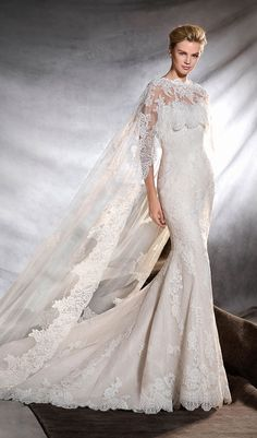 Try this inspiring mermaid wedding dress, fitted to the hips, with a strapless neckline. Skilled artisans have created this dress in tulle, lace and guipure, a magnificently feminine, romantic style. From Pronovias. Available at Schaffer's in Des Moines, Iowa. Wedding Dress Info: PRONOVIAS – STYLE ORINGO.