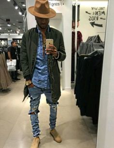 Wear an olive bomber jacket and baby blue distressed skinny jeans for a casual level of dress. Smarten up your outfit with beige suede chelsea boots. Shop this look on Lookastic: https://lookastic.com/men/looks/bomber-jacket-denim-shirt-skinny-jeans/18712 — Tan Wool Hat — Light Blue Denim Shirt — Olive Bomber Jacket — Gold Watch — Light Blue Ripped Skinny Jeans — Beige Suede Chelsea Boots