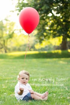 Personally, I like the simplicity of one single balloon. Red or pink would work great.