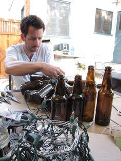 diy beer bottle chandelier - would be cool with the cobalt blue beer bottles