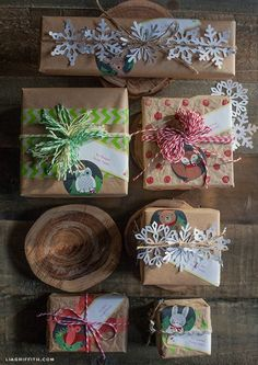 DIY Brown Kraft Paper Packages Tied Up with Baker's Twine and Printable Woodland Gift Tags and Silhouette Snowflake Pattern
