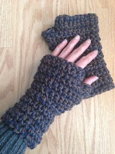 Thick fingerless mitts made with two strands of cotton yarn.