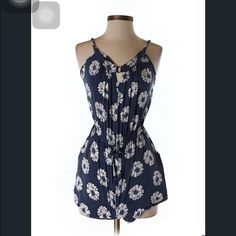 """Miami style floral romper Description: Dark Blue Floral Measurements: Chest 24"""", Length 20"""" Materials: Fabric details not available. Condition: This item is gently used Dresses"""