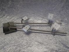Schöne Deckenleuchte mit je 2 quadratischen LED-Köpfen mit 4-Watt LED-Panels an zwei Armen.Der Clou: Die beiden Arme der Leuchte sind mit einem Gelenk auf der Hauptplatte angebracht und sind so flexibel schwenkbar. Die Leuchte kann also mit geraden Armen, als V oder in anderen Stellungen angebracht werden.Technische Daten:Leuchtmittel: LED 4 x 4 WattLumen pro Kopf: 320 LumenLichtfarbe: warmweiß 3000 KelvinEnergieeffizienzklasse: A Modell: N6964-17Herstellerempfehlung: 233€jetzt bei uns… Paul Neuhaus, Light Fixtures