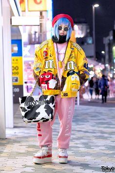 "Shoshipoyo on the street in Harajuku wearing a matching ""Versace & FUBU"" top and pants from Freak City with a Dog Harajuku bomber jacket, a Moschino cow print bag, and Nike platform sneakers (from Dog Harajuku)."
