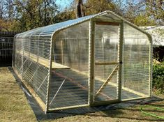 Step by step diy project about lean to greenhouse plans. Building a lean to greenhouse is a great weekend project, especially if you want to grow your own vegetables. Diy Greenhouse Plans, Greenhouse Supplies, Homemade Greenhouse, Lean To Greenhouse, Outdoor Greenhouse, Greenhouse Growing, Greenhouse Gardening, Greenhouse Wedding, Cheap Greenhouse