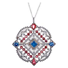 Measuring a substantial 2 inches tall (with the modest bale) and 1.75 inches wide, this beautiful rendition of vintage Americana boasts 3 carats of rubies, 2.22 carats of sapphires and 2 carats of diamonds. Set in platinum with an 18k yellow gold back and suspended from a vintage 18 inch diamond chain, this is a stunning important piece of antique jewelry, c 1910