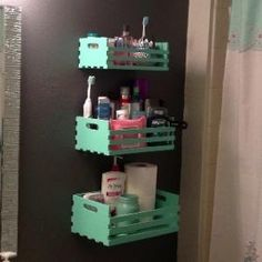 DIY Bathroom storage: $12. Hobby lobby plain wood crates, remove one side bar, paint sample from home depot ($3), and hang tiered for great storage in small places! by proteamundi