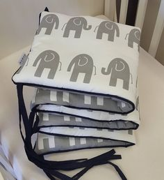 The combination of the grey and white ele on the reversible, padded cot bumper are a necessity for any baby nursery.   To see more of our baby linen ranges, check out: www.studiocollection.co.za