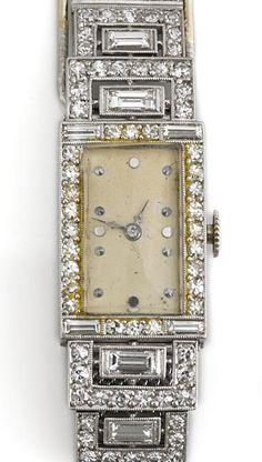 An art deco diamond and platinum bracelet wristwatch, Gübelin, circa 1930 18j, 7 adjustments; movement no. 31926; rectangular case and attachments set with baguette and single-cut diamonds, foldover clasp set with French-cut diamonds; with sliding adjustable bracelet