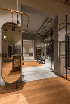 "dezeen: "" A continuous clothing rail runs through Comme Moi's first flagship store in Shanghai » """