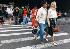 Tamu McPherson in an A.W.A.K.E. top, Re/Done jeans, Attico shoes, and Gabriela Hearst bag and Linda Tol with a Loewe bag