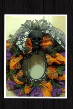 FRAMED! wooden black baroque style frame in orange & black paper mesh wreath with purple witch ribbon & black glitter skull that lights up