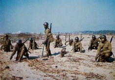 A unit of black GIs clear a beach of mines in Viareggio, Tuscany. With a few notable exceptions, black GIs in WWII were used for second line duties as the US military at the time did not feel black Americans equal to other Americans. Viareggio Italy, Pictures Of Soldiers, Italian Campaign, African American Men, American Revolution, North Africa, Colorful Pictures, World War Two, Wwii