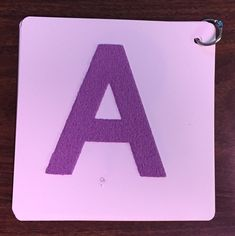 Create a tactile alphabet book for pre-braille students who are blind or visually impaired