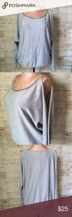 "✨NEW Listing✨Lane Bryant embellished sweater NWT Lane Bryant grey embellished cold shoulder sweater. Has a scoop neck with champagne gold bugle beads detail and open cold shoulder sleeves. Ribbed banded bottom. Length is 29.5"". Size is 22/24. Rayon/nylon. Not interested in trades. NWT Lane Bryant Sweaters Crew & Scoop Necks"
