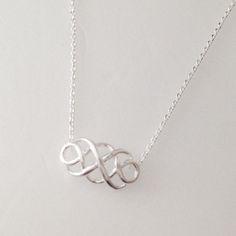Tiny Celtic Knot infinity Necklace in silver