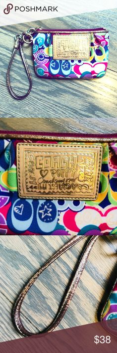 "Coach Poppy graffiti print small wristlet Rare Poppy multi-graffiti print (circa 2012)  Gold leather showing minor signs of distress  One small dirt stain along bottom rear edge (photo 5) No interior pockets   Measures 4"" x 6"" - cannot hold an iPhone 6 or larger Smoke free home Coach Bags Clutches & Wristlets"