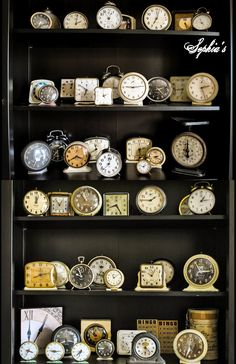 vintage clocks on shelves.. there's something so appealing about them!