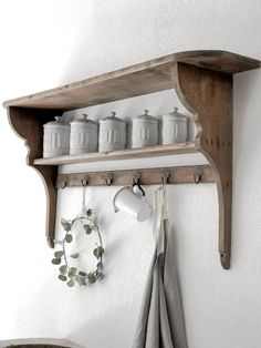 vintage wooden shelf from France  Great to display items on your kitchen  6 iron hooks  french country style  in great condition , original finish , solid heavy wood  measures 52 long x 24 tall top shelf 11 deep , middle shelf 5.5  deep